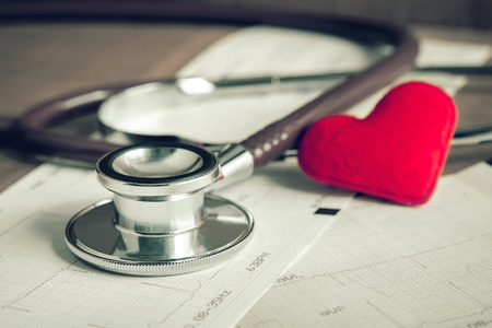 paper heart: Stethoscope with heart and cardiogram Stock Photo