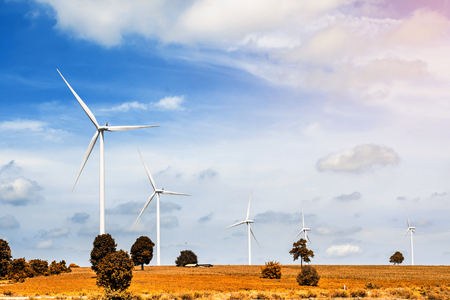 energy production: wind turbine for generate electricity with blue sky Stock Photo