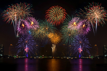Beautiful firework display for celebration with blur bokeh light background