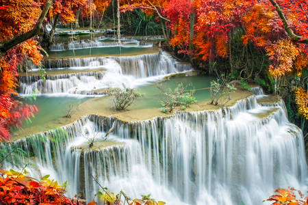 spring landscape: Beautiful waterfall in colorful autumn forest