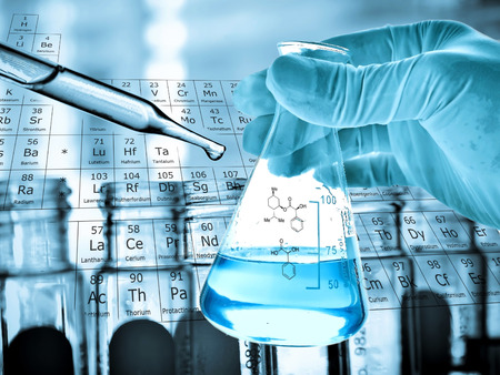 Flask in scientist hand with laboratory background Imagens - 48860360