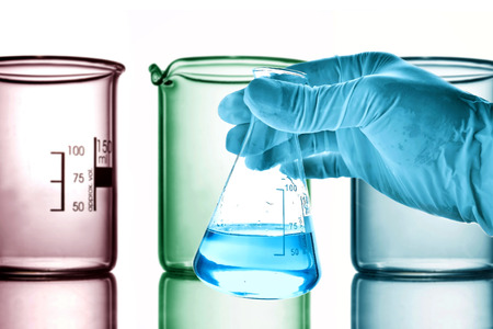 boiling tube: Flask in scientist hand with laboratory glassware background