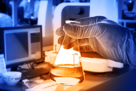 flask: Flask in scientist hand