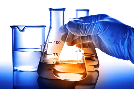 boiling tube: Flask in scientist hand with laboratory background