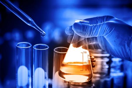 lighting technician: Laboratory glassware, science research and development concept