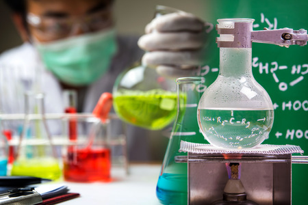 boiling tube: laboratory glassware with scientist background Stock Photo