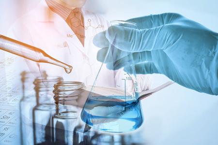 laboratory glassware with scientist background Stock Photo