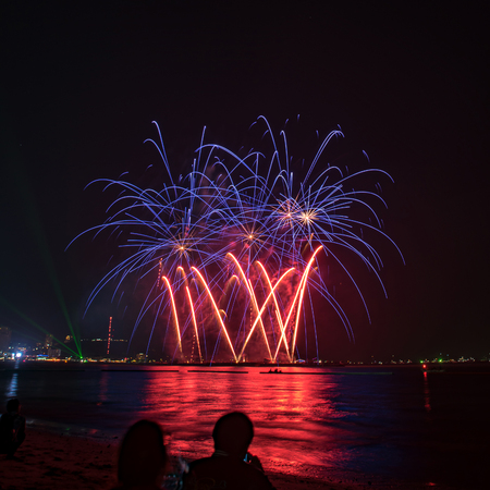 Beautiful colorful fireworks display on the water for celebration night