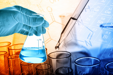 Flask in scientist hand with dropping liquid to test tube, Chemical, scientific research and development concept