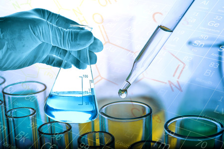Flask in scientist hand with dropping liquid to test tube, Chemical, scientific research and development concept Banque d'images