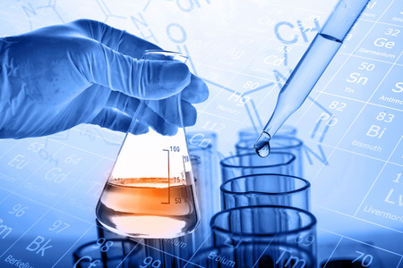 Flask in scientist hand with dropping liquid to test tube, Chemical, scientific research and development concept Stok Fotoğraf