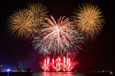 Beautiful colorful fireworks display for celebration on dark sky