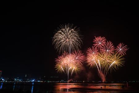 Beautiful colorful firework display at the sea on celebration night
