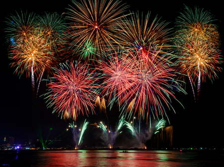 Beautiful colorful firework display on the sea for celebration night