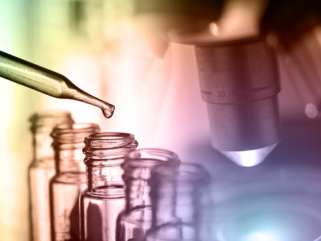 Microscope with lab glassware, laboratory research and development concept, lab analysis