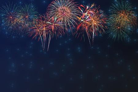 Beautiful colorful fireworks display for celebration on dark sky