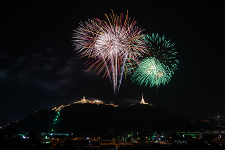 Beautiful Fireworks display on dark sky for celebration night 스톡 콘텐츠