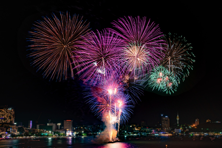 Amazing colorful firework display on celebration night, happy new year festival concept 스톡 콘텐츠 - 122891602