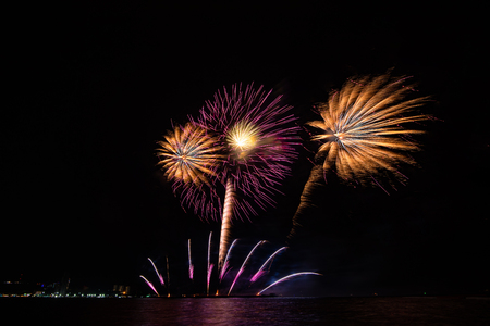 Amazing colorful firework display on celebration night, happy new year festival concept Stockfoto - 122891612