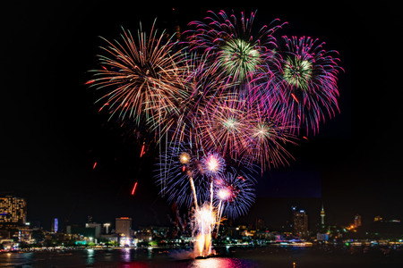 Amazing colorful firework display on celebration night, happy new year festival concept 스톡 콘텐츠 - 122891613