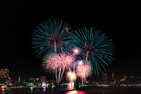 Amazing colorful firework display on celebration night, happy new year festival concept