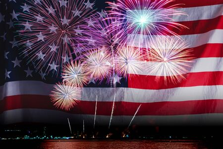 Double exposure of Amazing beautiful colorful fireworks display on celebration night with USA flag, showing on the sea beach with multi color of reflection on water. 4th July Independence day concept Stockfoto - 132148874