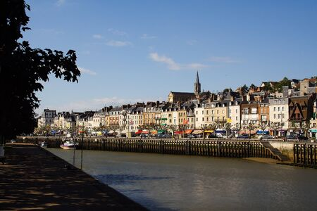 the quay: Overview of Trouville, quay, boat, restaurants and row of houses