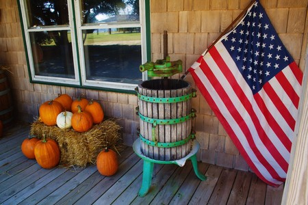 wood panelled: Not long before halloween, pumkin and an american flag in a rural setting Stock Photo