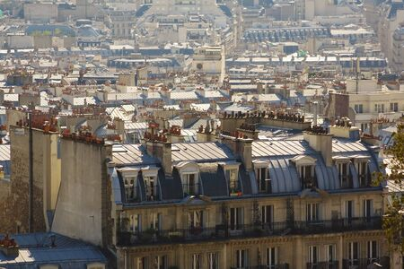Overview of the roofes of Paris, with a main building on the front.