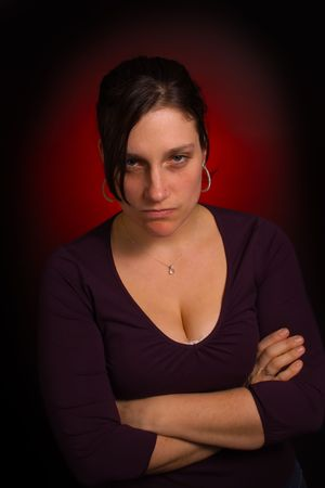 resentful: Resentful, irritated and moody female model Stock Photo
