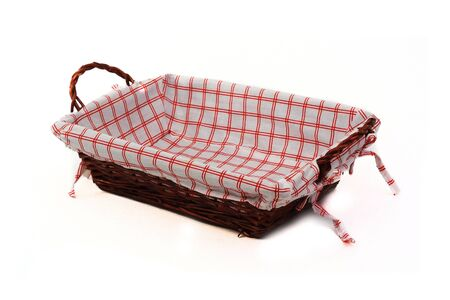 clothe: Cane bread basket isolated over white made in cane, with internal clothe