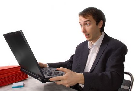 Young man freaks out in front of laptop, isolated over white