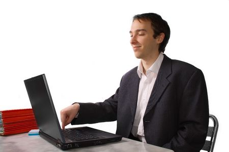 Young man proudly finishes work on laptop, isolated over white photo