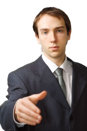 Young business man hand shake with focus on face, isolated over white