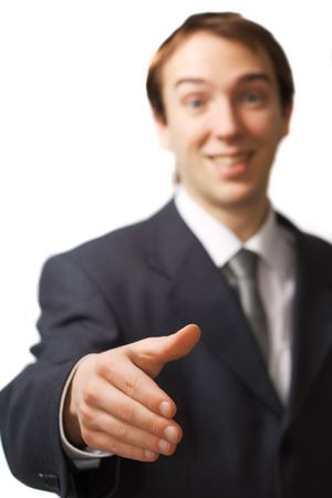 Happy young business man hand shake with focus on the hand, isolated over white photo
