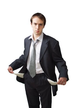 Young business man shows his empty pockets, isolated over white