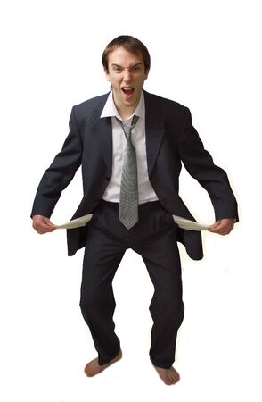 deposed: Young man shouts showing his empty pockets, isolated over white Stock Photo