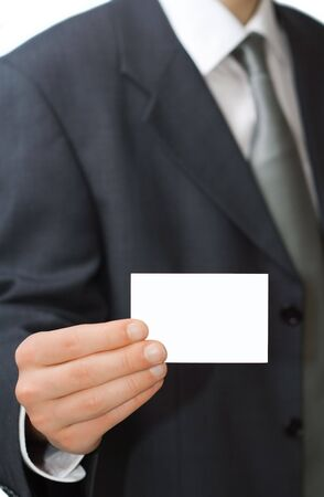 Young professional shows his business card