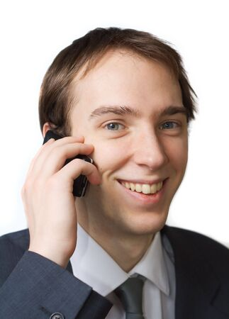 Young professional smiles while on the phone, isolated over white