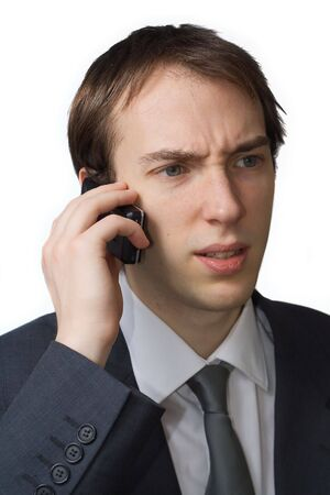 Young professional, worried on the phone, isolated over white Zdjęcie Seryjne