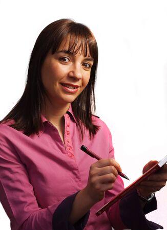 Woman in fushia shirt takes notes, isolated over white