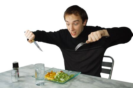 Hungry young man ready to eat, isolated over white backgroud