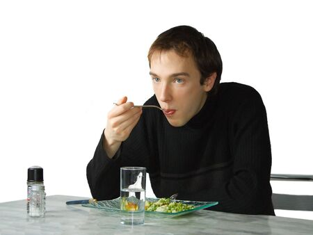 Young man eating, isolated over white