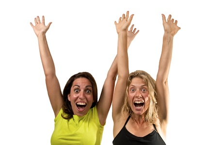 brune: Happy women cheers with hands in the air Stock Photo