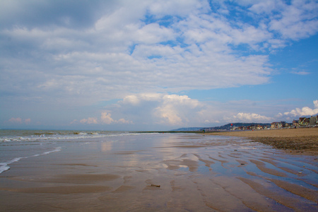 Trouville beach at low tide with cloudy colorful sky