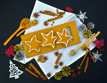 Preparing for Christmas. Homemade pastries on a wooden background. Top view. Food New Year. Aromas of the holiday. Comfort.
