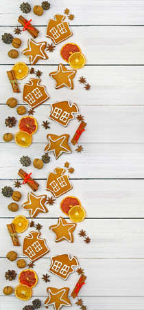 Festive ornament of spices, nuts, cones, fruits, berries, homemade gingerbread. Christmas decor in a rustic style. Christmas background.