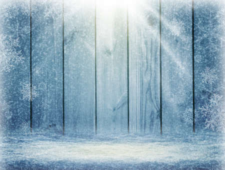 Blue christmas background. blizzard New Year Frame for your text. Winter background. Sun rays and snowfall. Knowy Plank With Wintry Background.