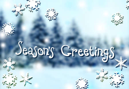 Blurred winter background with handwritten text. Season of greetings. Christmas New Year.