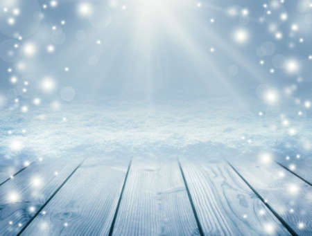 Blue christmas background. Christmas table background and blizzard. New Year Frame for your text. Winter background. Sun rays and snowfall. Knowy Plank With Wintry Background.